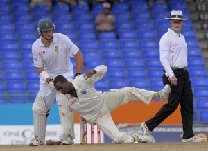 Shane Shillingford fields during his follow through - Brooks La Touche Photography and DigicelCricket.com