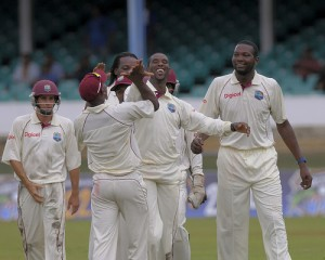Shane Shillingford gives Dwayne Bravo a high five for taking the catch to give him his first Test scalp - Brooks La Touche Photography and DigicelCricket.com