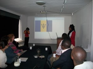 Sheena at extrenme right delivers presentation to Cape Town residents on Barbados in the Caribbean