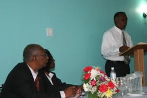 (L-R) Premier of Nevis and Minister responsible of Security Hon. Joseph Parry and Permanent Secretary in the Premier's Ministry Ms. Angelica Elliot listen to Leader of the Opposition Hon. Vance Amory at the Symposium on Crime hosted by the Premier's Ministry