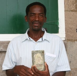 President of the Nevis Turtle Group and Director of Fisheries in the Nevis Island Administration Mr. Lemuel Pemberton displays the satellite tracking transmitter retrieved from Ginger