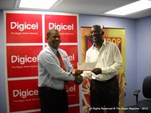 Alex Tasker of Digicel hands over sponsorship cheque to NCF's David Jordan