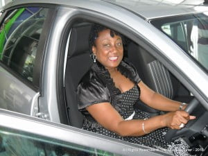 Dr Donna Hunte Cox gets a feel what the victor will experience a fortnight from now when Barbados has its 2010 Calypso Monarch for Pic O'De Crop