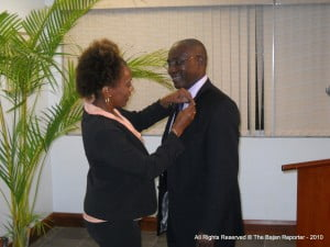 The Agriculture Minister receives his CHSB pin amidst great applause at UWI's popular restaurant