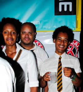 "In the background, can it be? In an old school Uniform? The Country Manager of LIME (Barbados), Alex MacDonald? Make him do 500 lines, ""I must not disobey the Minister..."" IMAGE COURTESY: Nigel Browne"