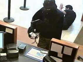 A photo taken from video and provided by the Suffolk County Police Department shows a person dressed as Darth Vader robbing a Chase bank in Setauket, N.Y. {IMAGE VIA: AZ Central & Suffolk County (N.Y.) Police Department}