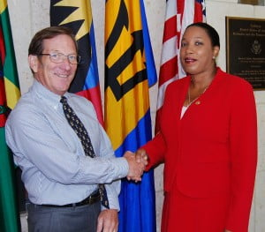 Gail Henry meeting with Charge D'Affaires James Goggin (left) at the Embassy on her return to Barbados from the IVLP.