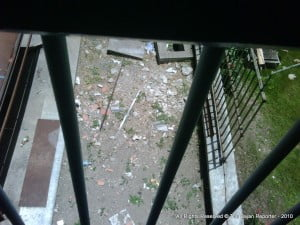"""""""Barbadians know that a patient can be in pain and in serious need of treatment without their case being categorized as an emergency."""" {QEH Stairwell near wards with decades of filth inside}"""