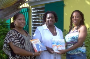 St. Martin's Home manager MacFolda Gumbs (center) receiving copies of Same Sea … Another Wave from HNP's senior editor Rhoda Arrindell, while HNP's book launch committee member Sorellis Peters holds the additional gift publications, including the music CD Fête by Tanny & The Boys. (Saltwater Collection photo)