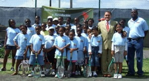 Venezuela's Resident Ambassador His Excellency Cruz De Jesus Bello and Director of Sports Dave Connor (right) poses with advanced participants from tennis camp