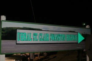 The new road sign which carries the name of local hero and Zion Businessman Mr. Uhral St. Clair Swanston after it was unveiled by the honouree. The sign is erected at the bottom of Zion Hill