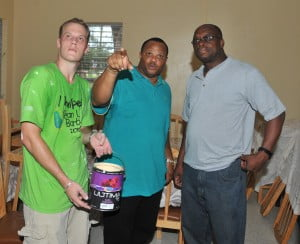 (L-R) Senior Vice President of Sales and Marketing at Harris Paints Luke Ticknor looking at the painted Cottage at the Nightengale Children's Home with  Minister of Social Care, Constituency Empowerment, Urban and Rural Development, the Hon. Christopher Sinckler and Parliamentary representative for the St.Michael West Central area, James Paul