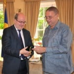 {FILE PHOTO} Bds' PM David Thompson (R) & UK High Commissioner Paul Brummell (L)