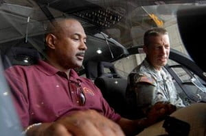 Assistant Director of Plans, Intelligence and Law Enforcement for the RSS , ACP Ian Queeley  of St. Kitts (left) examines equipment with a Florida National Guardsman.