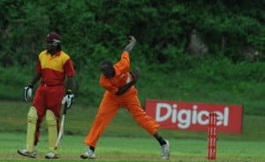 The World's Fastest Man, Usain Bolt, bowls during the Digicel-sponsored Chris Gayle Pro 15/15 held in St. Ann, Jamaica, as Gayle looks on. Bolt's team beat Gayle's on faster run-rate during an exciting day of cricket.