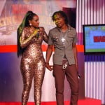 New Host Yanique at work in her skintight outfit seen here with contestant Triple R