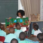 U.S. Embassy Political Officer Kristin Mencer reading from Good Night Moon for Reception students at Milton Lynch Primary School.