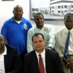 Delta Petroleums delegation L R Front Bevis Sylvester Andrew Vascollenous Back Row Diego Penn Samuel Mc Sheen and Rawle Nelson
