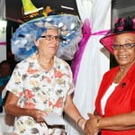 Dorothy Golmes most humorous hat collecting prize from Barp Vice President Norma Roach