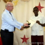 Acting High Commissioner Phil Culligan makes a presentation to Victor Ramkissoon June 2012