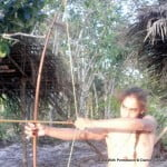 Tikenti Auguiste with bow shooting the runner sacrifice