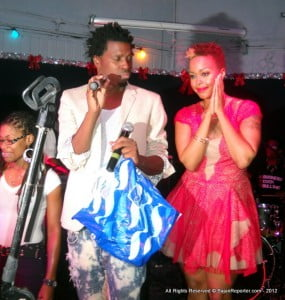 Just before she sang,  Chrisette Michele handed out Tee Shirts to the excited participants -  Trevor pretty seen here holding the bag of tees for the DefJam singer