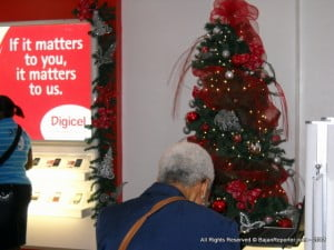 Shoppers for the latest in Mobile technology are not just for Teenagers, but the young at heart - as proved by this customer near the sparkly tree!