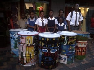 Children pose next to the refuse bins that they designed. The bins will be placed throughout Swan Street.