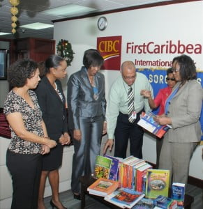 Soroptomist, Pansy Griffith (second from right) explains to Mark St. Hill, CIBC FirstCaribbean's Country Head for Barbados and Gracie Elias, Manager, Barbados Strategic Business Unit (right) how the reading materials will benefit girls and young women at the Government Industrial School with (from left) other Soroptomists, Judith Toppin, Tammy Bryan and Sisporansa Stanford.