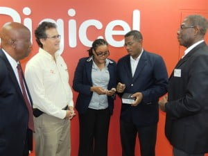 Alex Tasker (second from right), Commercial Director of Digicel (Barbados) Limited, in conversation with Laura Hoyte (centre), Member of the Barbados Renewable Energy Association (BREA). Also pictured here are (L-R) Clyde Griffith, CEO of BREA, Henry Jordan, BREA Member and Rawle Chandler, President of the Board of BREA.