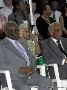His Excellency (extreme left) conveys Christmas greetings to all Barbados