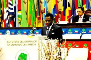 President Obiang gives remarks for the closing ceremony of the 7th Summit of Heads of State and Government of the African, Caribbean and Pacific Group of States (ACP countries) in Malabo, Equatorial Guinea. Equatorial Guinea's Press and Information Office. In the background you can see Dr Kenny Anthony of St Lucia