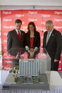Left to right, Digicel Chairman, Denis O'Brien, Haiti's Minister of Tourism, Stéphanie Balmir Villedrouin and Marriott International President and CEO, Arne Sorensen admire a model of the new hotel