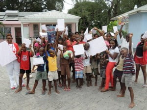 """Ready to Learn! Residents"" of the Nightengale Children's home were ecstatic about receiving their educational gifts, books and stationery from Digicel."