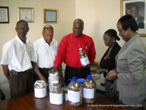 (L to R) SSA's Plant Supt. Derek Breton, SSA's Supt. of the North Depot – Terence Mitchell oversee the transfer of the pennies from SSA Manager Stanton Alleyne to Ms Pamelia Brereton – Pres. Of the Alzheimer's Assoc. and Mrs Octavia Gibson, of the CBB's Currency Dept.