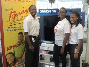 Alison Weekes, (center) was very happy to receive her new Samsung 40 inch LCD TV compliments Digicel, represented here by Shakida Grant (right), Marketing Executive with Digicel (Barbados) Limited. Also pictured is Courts General Manager, Davidson Ishmael.