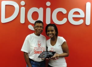 Shakida Grant (right), Marketing Executive with Digicel (Barbados) Limited, shares a smile and a new Samsung Galaxy Tab 2 with Week Two winner, Dorothy Grazette.