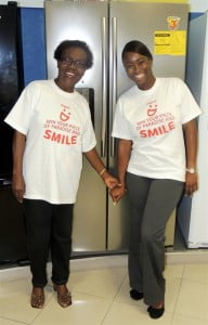 Krystle Smith (right), Senior Marketing Executive with Digicel (Barbados) Limited, shares a smile with Week One winner, Shirley Weekes in front of her new Samsung refrigerator at the Courts Superstore in Bridgetown.