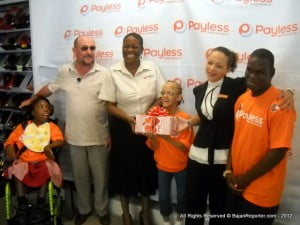Variety's Chief Barker Colin Brewer (in shades) with Executive Director Donnah Russell to his left, receive the vouchers for 200 needy children from Payless Hastings' Mgr Alison Haynes (2nd from Right)