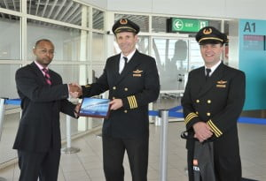 Welcome plaque presented to Delta Air Lines at SXM Airport on the occasion of the JFK-SXM inaugural flight (12/14/12): SXM Airport's Manager of Special Projects Robert Brown (L), Delta Captain Bob Reynolds (C) and First Officer Herb Ludwig. (SXM Airport photo)