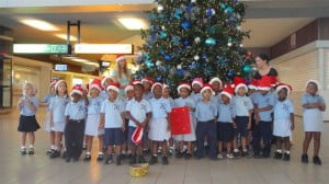 Students of the Sister Regina Primary School about to serenade passengers and other airport users on Tuesday. (SXM Airport photo).