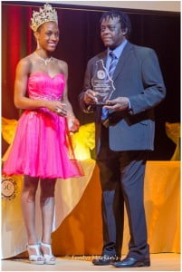 "Justin ""Hero"" Cassell who won Montserrat's Calypso crown a record ten times accepts his award from the new Miss Montserrat Kadijah Furlonge at the Montserrat Festival 50 Awards Ceremony and Banquet on January 2, 2013 at the Cultural  Centre. (A Wayne Fenton Photo)"