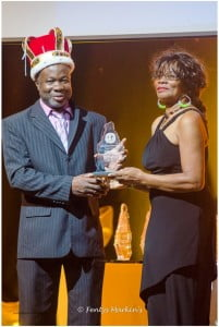 "Miss Montserrat 1965 Rose Willock accepts her award from the reigning calypso king Herman ""Cupid"" Francis at the Montserrat Festival 50 Awards Ceremony and Banquet on January 2, 2013 at the Cultural  Centre. (A Wayne Fenton Photo)"
