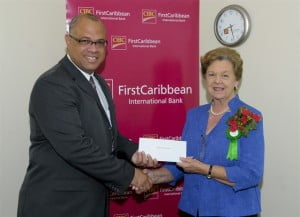 Mark St. Hill, Managing Director for CIBC FCIB presents the cheque to Dr. Dorothy Cooke Johnson who receives it on behalf of the Cancer Society and the Breast Screening Programme.