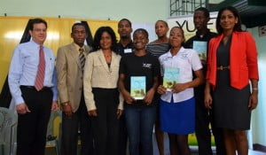 Minister of Youth and Culture, Honourable Lisa Hanna (right) is delighted to stand next to YUTE Programme participants who were the first to be handed their personal copies of the booklet, Services For Urban Youth.  Sharing the moment are supporters of the YUTE Programme (l-r), Mr Joseph Matalon - YUTE Programme Chairman; Mr Billy Heaven - Chief Executive Officer of the CHASE Fund and Mrs Debbie Guiness-Brown – Wellness Programme Co-ordinator at the National Health Fund.  Ms. Maureen Webber - YUTE Programme Manager (6th left) is also present