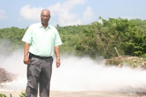 Premier of Nevis Hon. Joseph Parry during a visit to geothermal well in 2008 with proof of geothermal energy in the background at Spring Hill (file photo)