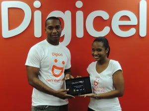 Simon Gaskin (left) collecting his brand new Samsung Galaxy Tablet from Digicel Marketing Executive, Shakida Grant.