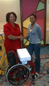 President Erica Hall (right) presenting the Wheelchair to the Ms. Bourne of the St. Andrew's Parish Church.