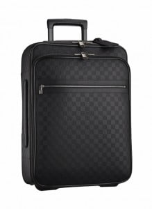 """With its wide opening, it allows a quick view and easy access to personal belongings, inside, a wide zipped pocket and several compartments help organizing oneself. Pégase 55 business suitcase new in black Damier Infini brings in great functionalities for a business trip with its front compartment for iPad, laptop, cables, phone, flight ticket… and enables to travel """"handsfree"""". The collection launches at Limegrove in April"""