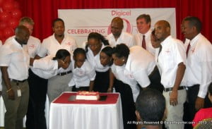 Commercial Director Alex Tasker (extreme Right) and Barry O'Brien (4th from Right)join with Digicel employees who made their mark by staying 5 years with the Network in sharing Birthday cake...